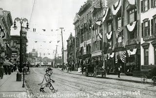 Street scene with buildings decorated with patriotic bunting