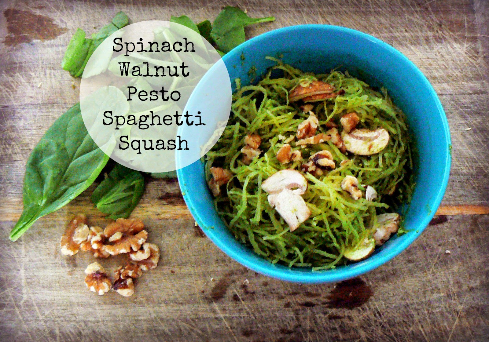 spaghetti squash with pesto, spinach, and walnuts