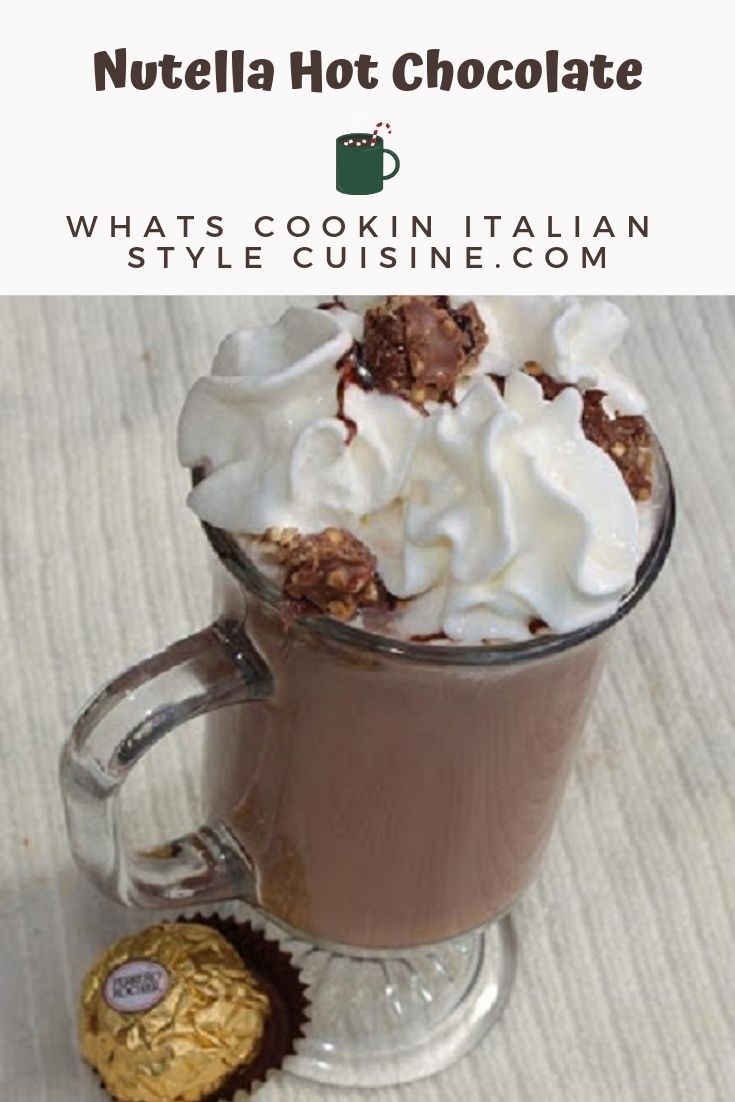 This is a photo and pin for later hot cocoa made with Nutella. It is topped with whipped cream and ferraro rocher candy