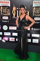 Varalaksmi in Green Glittering Sleeveless Backless Gown at IIFA Utsavam Awards 2017  Day 2  Exclusive 21.JPG
