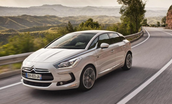 Citroen DS5 Hybrid4 driving on a country road