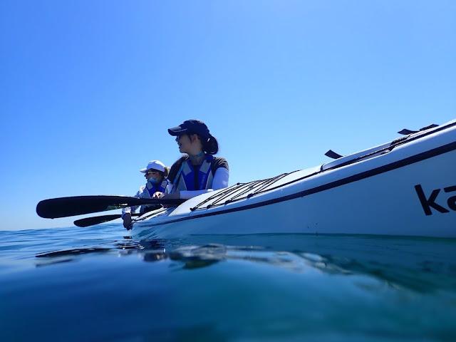 Girls on sea kayak