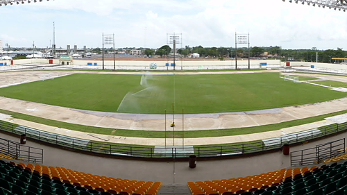 Soccer fields have stands in two halves of the world