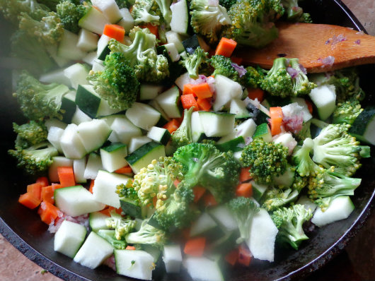 Sauté onion and chopped vegetables