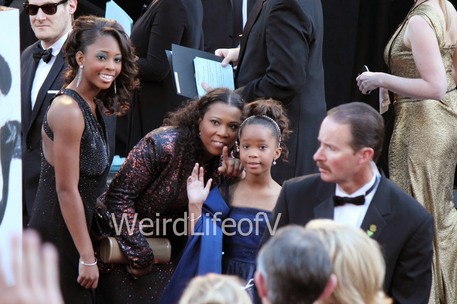 Quvenzhane Wallis shyly waves to the fans