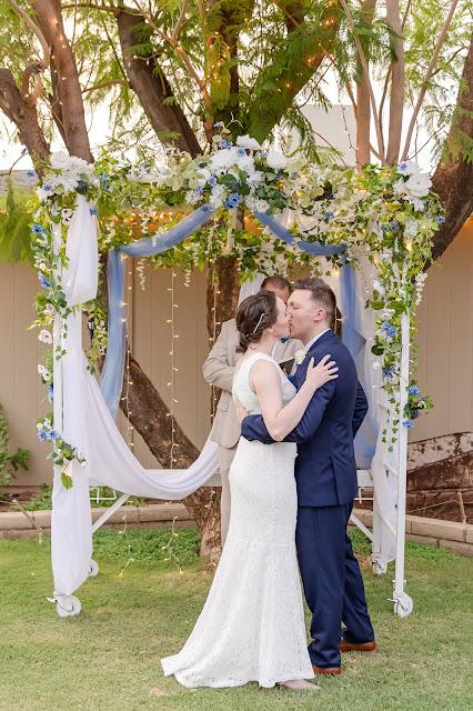 first kiss at wedding ceremony at a backyard AZ wedding in july
