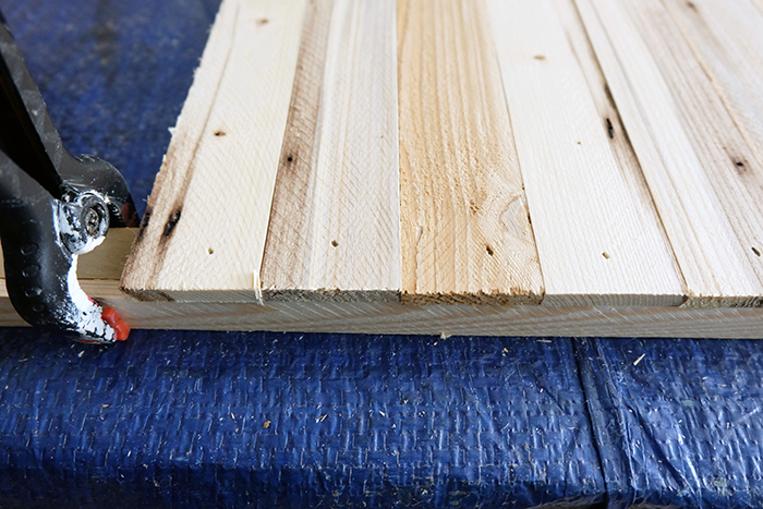 wood lath pieces attached to square dowel for front panel