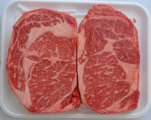 A pair of gorgeous USDA Prime, Certified Angus Beef Brand ribeye steaks from Food City.