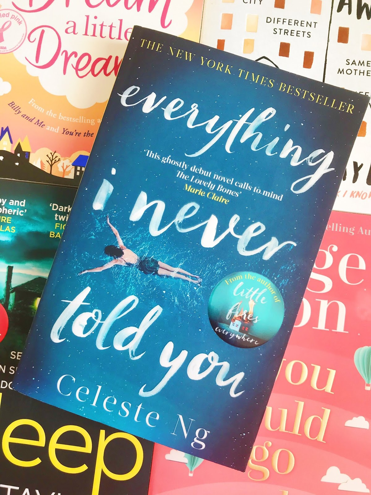 Everything I Never Told You by Celeste NG book on top of 4 other books