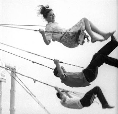 Vintage photo of kids swinging