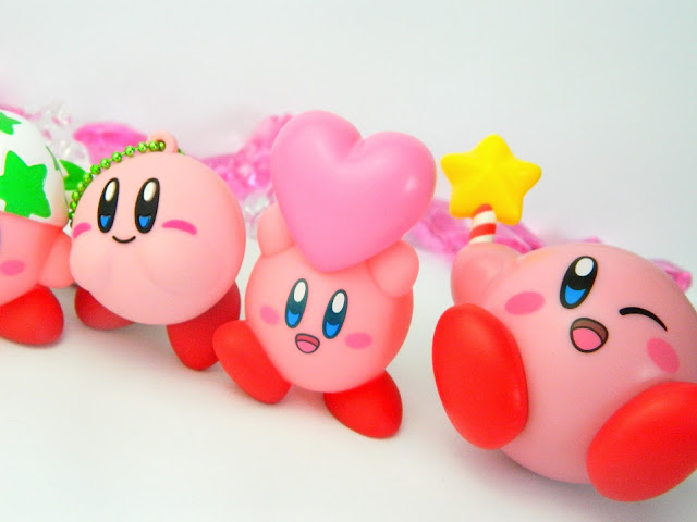 Three Nintendo Kirby figures in a row