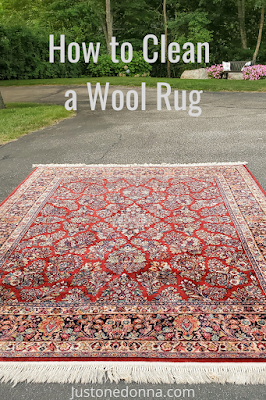 You can easily clean a wool rug at home.  Read how.