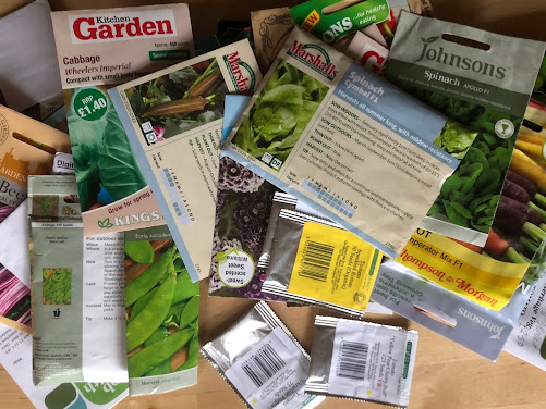 A jumble of seed packets