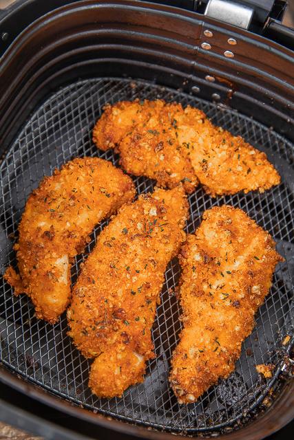 baked chicken in an air fryer basket