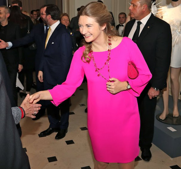 Princess Stephanie wore a fuchsia color Prada Dress, Prada Bordeaux Coloured suede shoes, Prada Bordeaux Coloured clutch bag and Colored stone ruby necklace and ruby ring