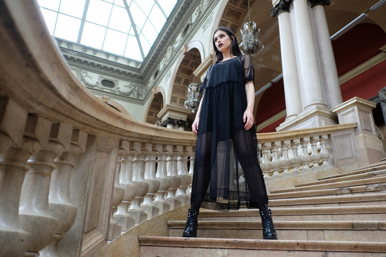 woman wearing black, sheer outft