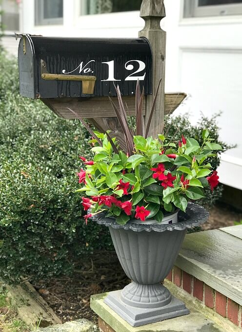 Mailbox with potted plant in iron planter