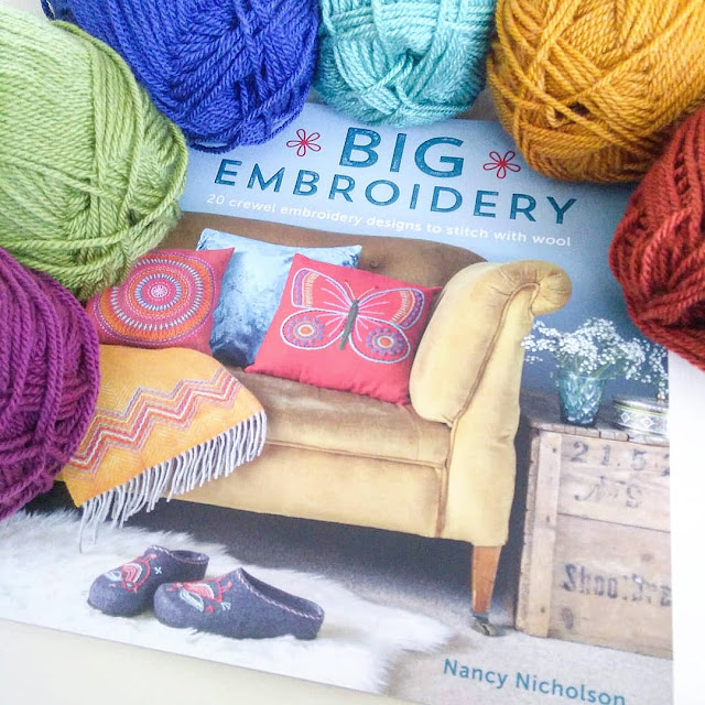 Big Embroidery by Nancy Nicholson surrounded by Stylecraft Special DK