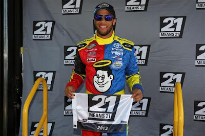 Darrell Wallace Jr., driver of the #54 Camping World Toyota, celebrates with the pole award after qualifying for pole position for the NASCAR Camping World Truck Series Lucas Oil 200 at Dover International Speedway on May 31, 2013 in Dover, Delaware.