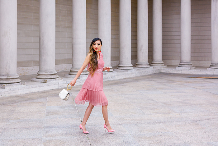 pleated dusty pink one shoulder dress, chloe nile bag, tassel earrings, christian louboutin pink pumps