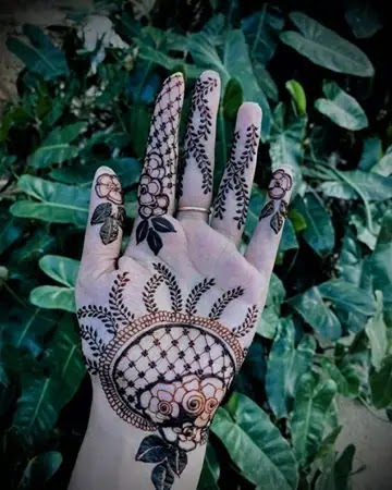 Back_ hand_flowers_net_and_small_big_leaves_design_for_karwa_chauth