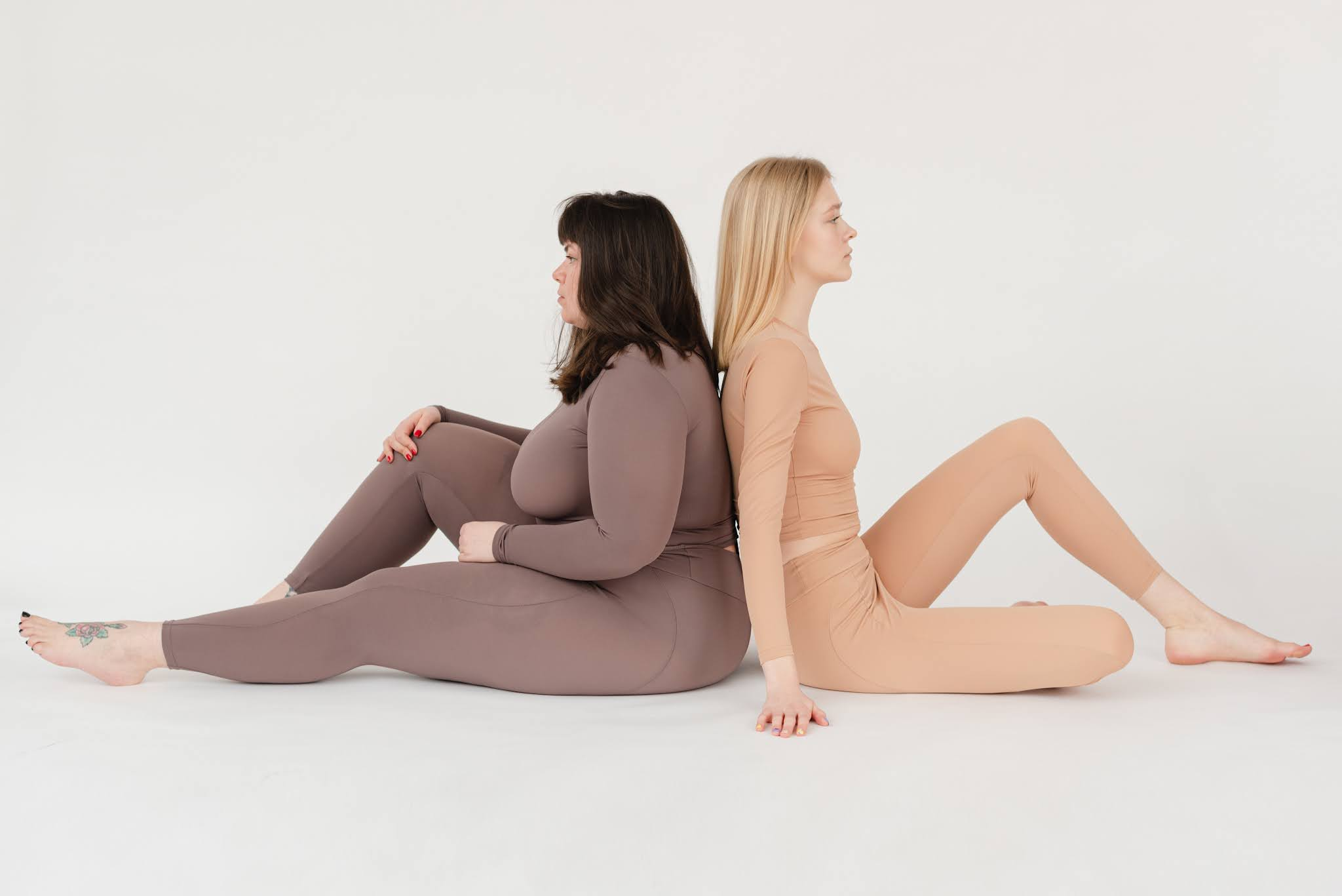 This picture is of two women who wearing the best shapewear for tummy