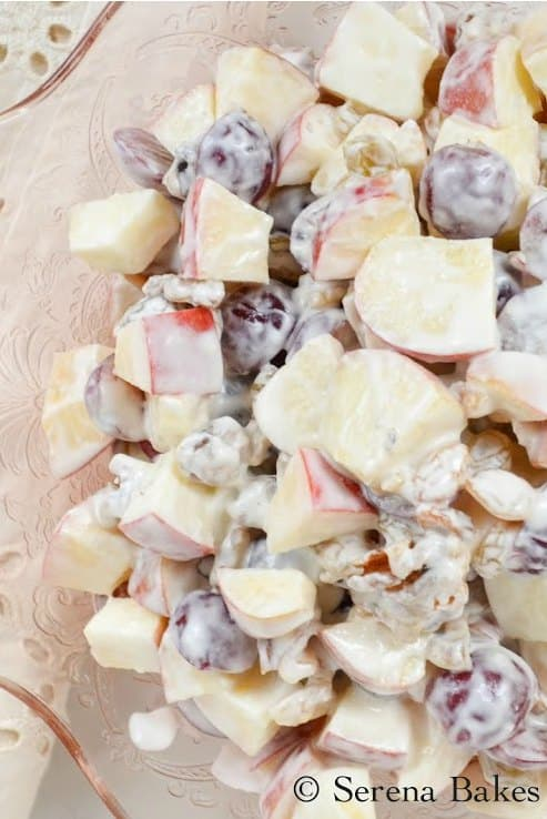Classic Waldorf Salad is made all the better by the addition of greek yogurt and honey. With apples, grapes and walnuts this is a favorite salad for Thanksgiving and Christmas dinner and delicious for potlucks from Serena Bakes Simply From Scratch.