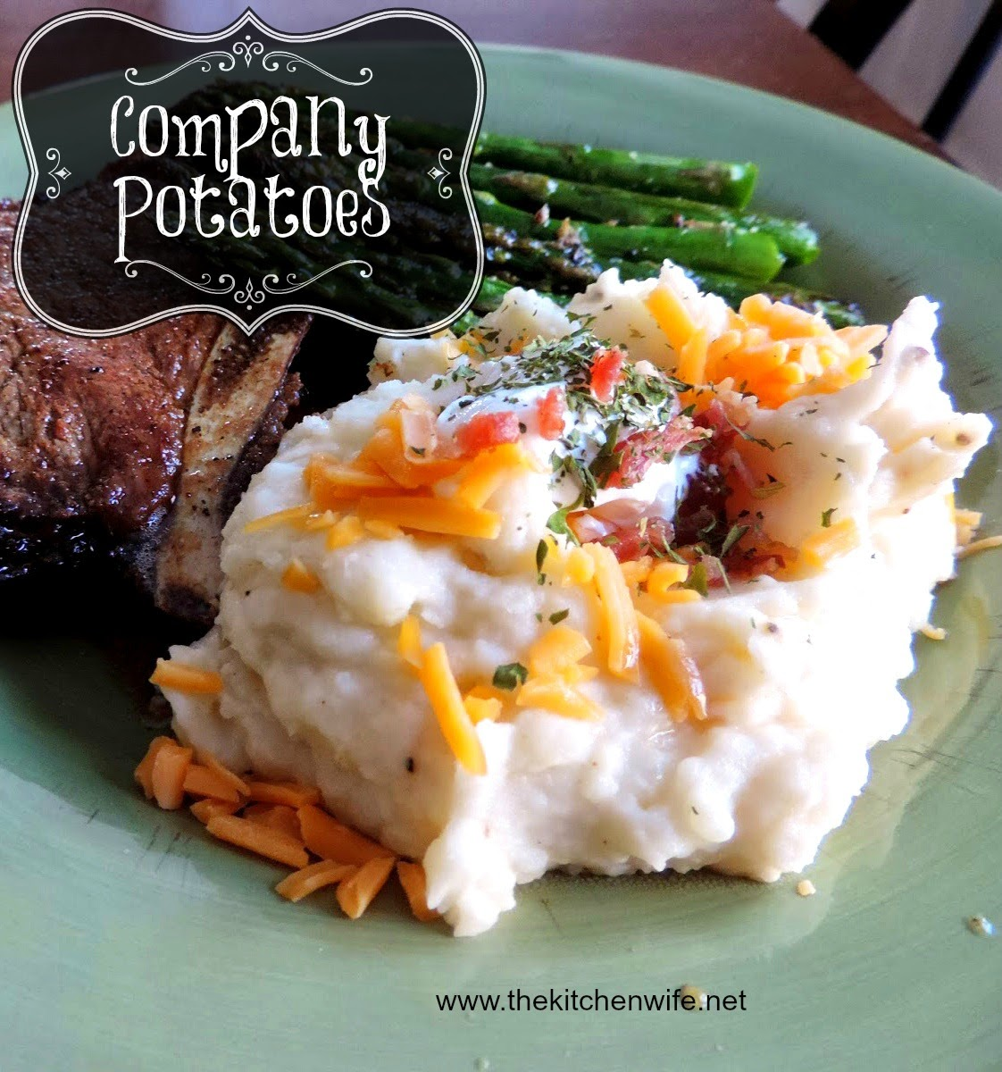 The finished mashed potatoes on a plate with steak and asparagus.