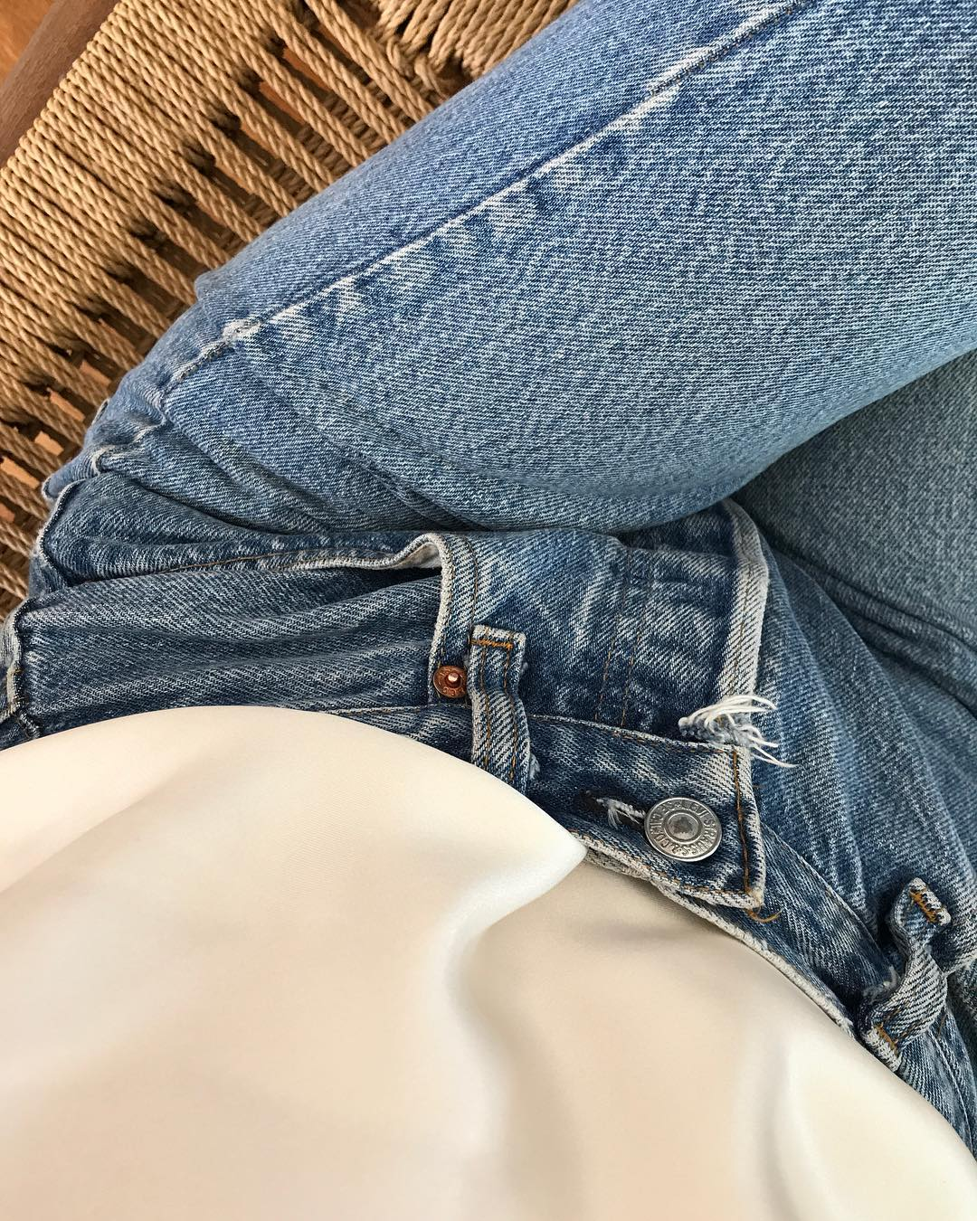 Easy Spring Outfit Idea from Instagram with an ivory silk tank top and classic Levi's jeans