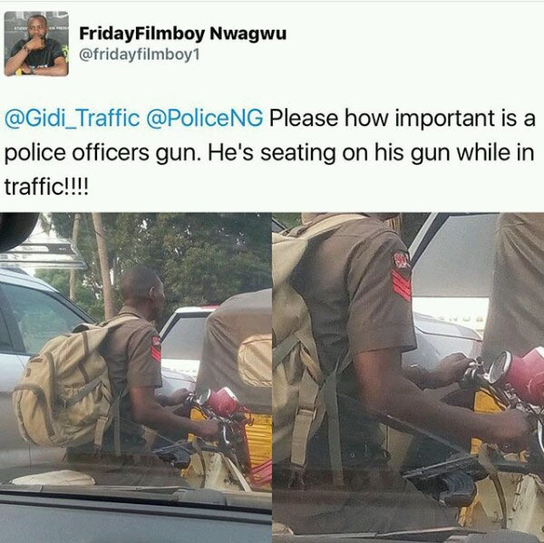Nigerian policeman sitting on top of his gun while driving okada