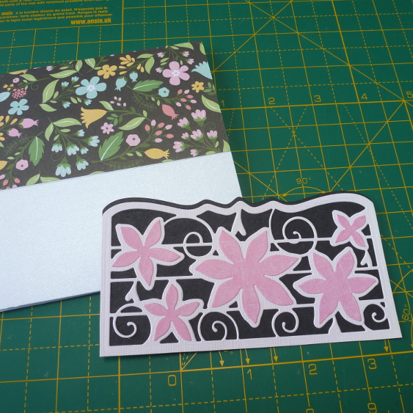Cut the Tonic Studios die to make a pocket section for the front of the greeting card black and pink colors used