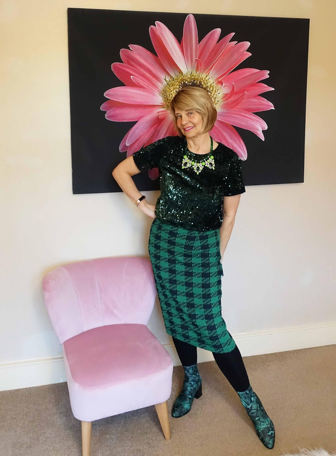 Green houndstooth skirt paired with green sequin top and green snakeskin boots. Sassy over 50s style from Is This Mutton?