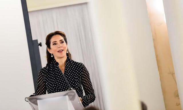 Crown Princess Mary wore a polka dot silk shirt dress from Carolina Herrera. Dulong Fine Jewelry pearl earrings