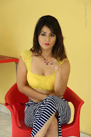 Cute Telugu Actress Shunaya Solanki High Definition Spicy Pos in Yellow Top and Skirt  0451.JPG