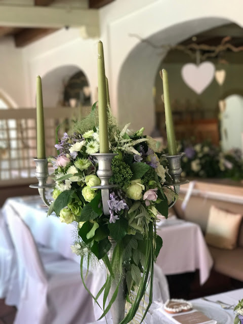 Silver candelabers with flowers, Table decor with Hessians, wood, grey, brown, green, lilac, Wedding abroad, Mountain wedding lake-side at the Riessersee Hotel Resort Bavaria, Germany, Garmisch-Partenkirchen