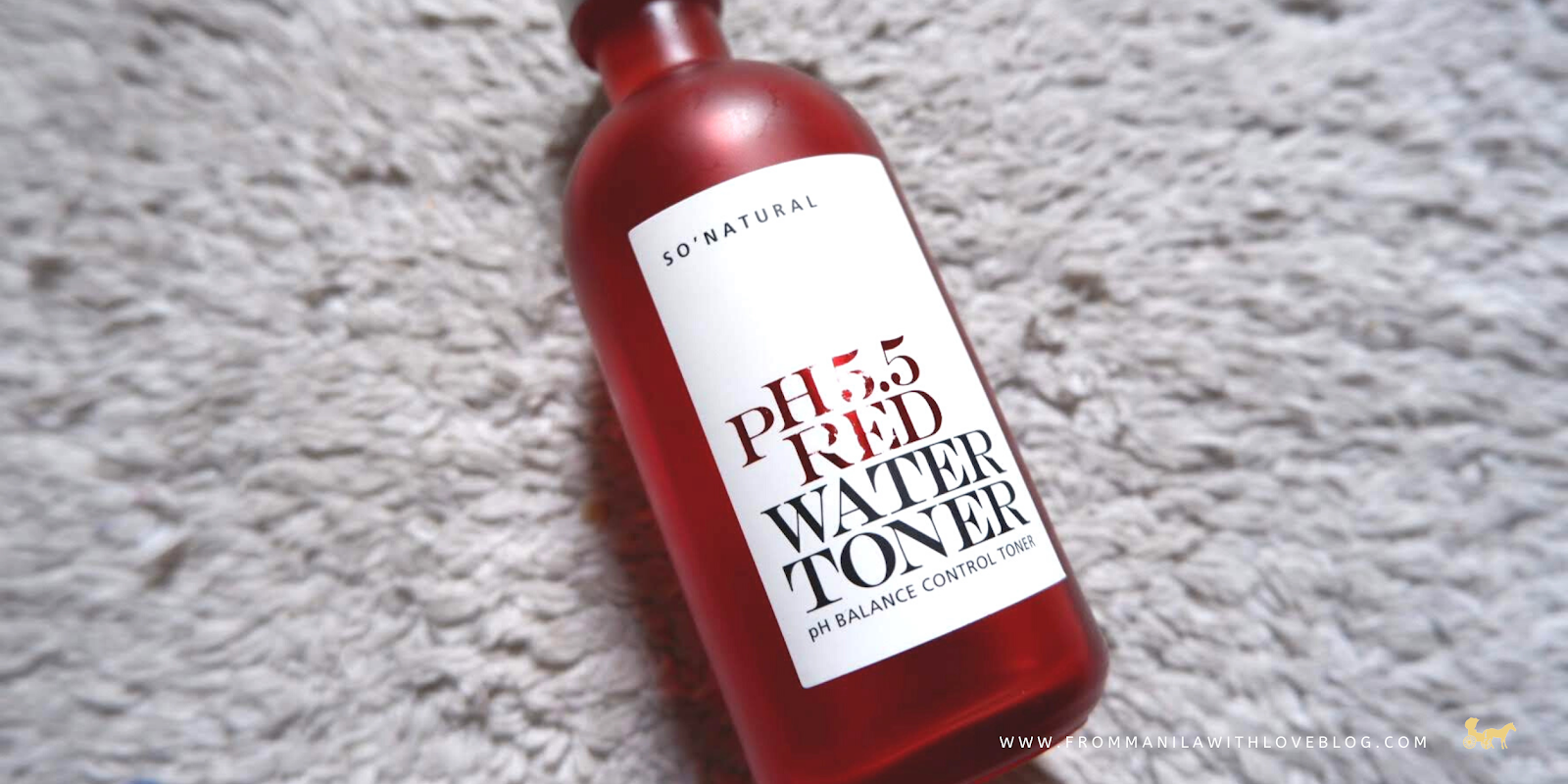 an image of a matte glass red bottle on a rug