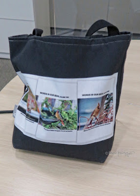 "This photo features one of  the tote bags I have designed. The one here has a has a black background and is sitting on a table.  The item is made of poly-poplin.  My totes come in three sizes (13"" by 13,"" 16"" by 16,"" and 18"" by 18"") each item the one seen here is 13"" by 13.""  Each tote includes a one inch strap for easy carrying on your shoulder. All seams are double stitched for added durability. These are machine washable (in cold water) and the same image (in this case that image is of the book jackets for my three volume book series, ""Words In Our Beak.""**) is printed on both sides.  *Info re this tote is @ http://bit.ly/2UlBrRU **Info re these books is @ http://bit.ly/2EdADpx"