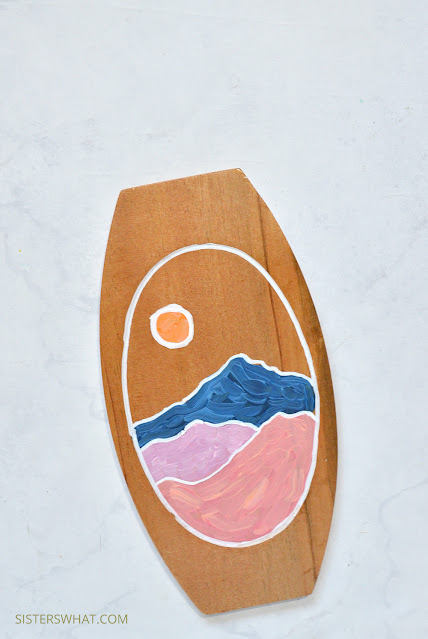 abstract mountain painting on thrift store plate