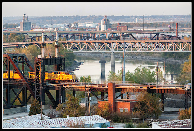 UP 6838 leads a train east on the Highline Bridge at Santa Fe Junction.