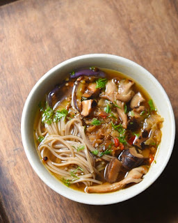 Asian style soba noodle soup with assorted mushrooms and brinjal