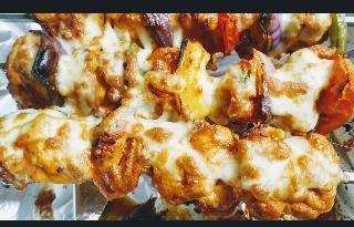 Crisp roast mozzarella chicken kebab in shewer