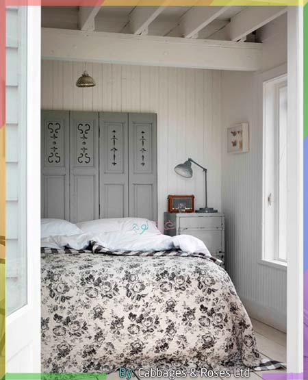 غرفة نوم صغيرة بالأبيض والرمادي