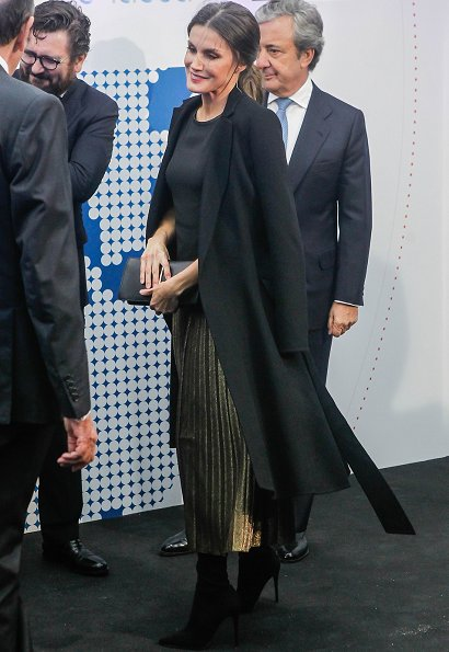 Queen Letizia wore pleated sequin midi skirt, carried Nina Ricci arch clutch bag and Carolina Herrera wool coat