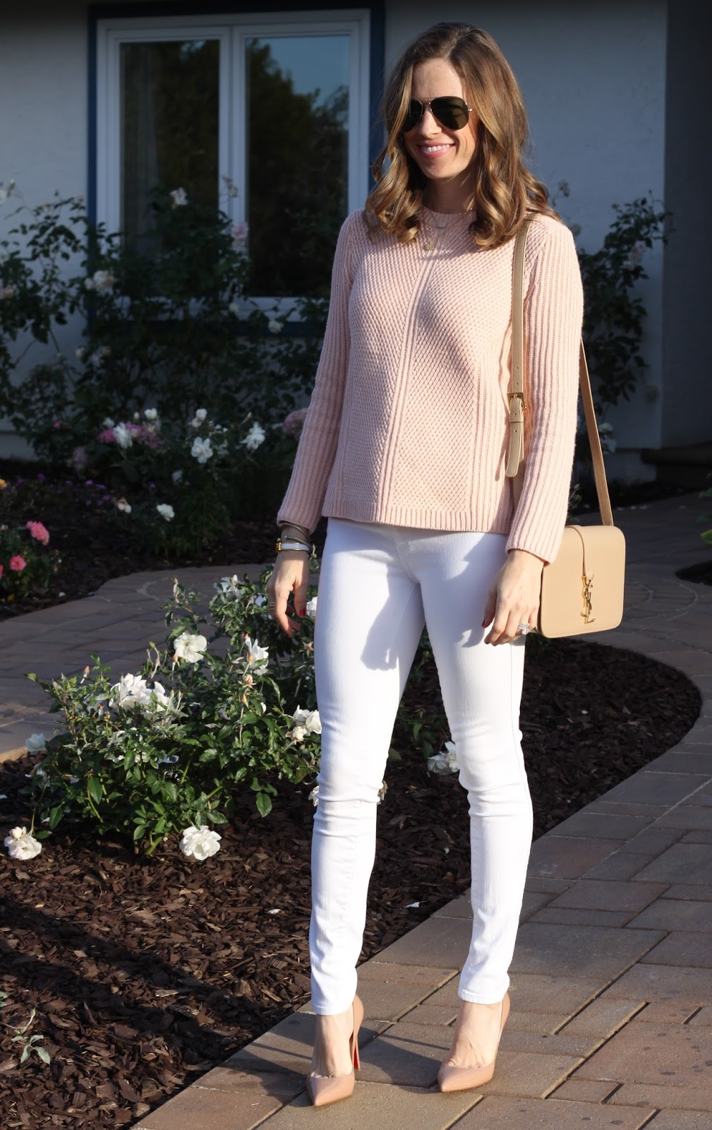 blush sweater and white jeans