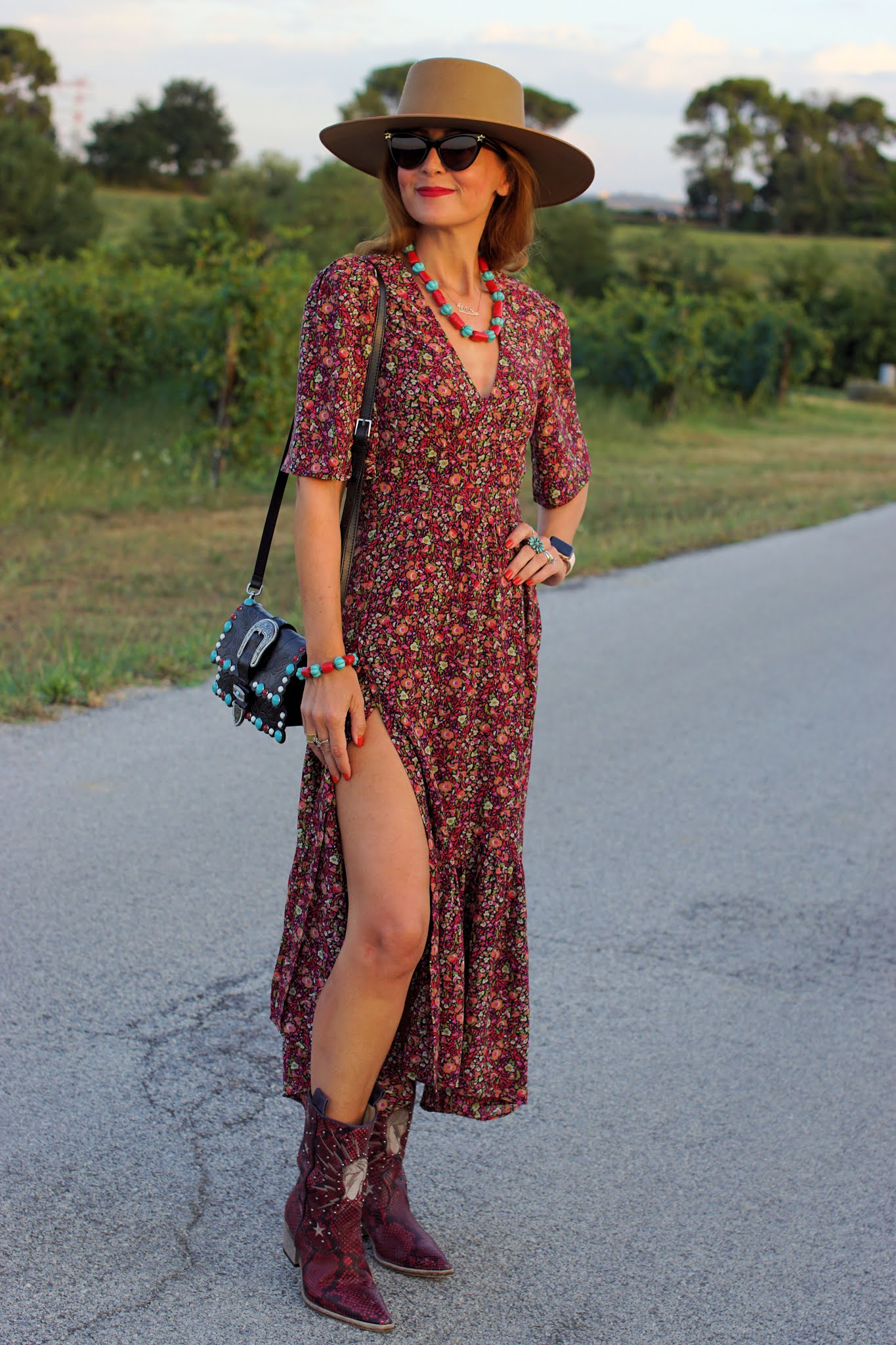 A transitional western style outfit with a ba&sh Paris dress and Lack of Color hat