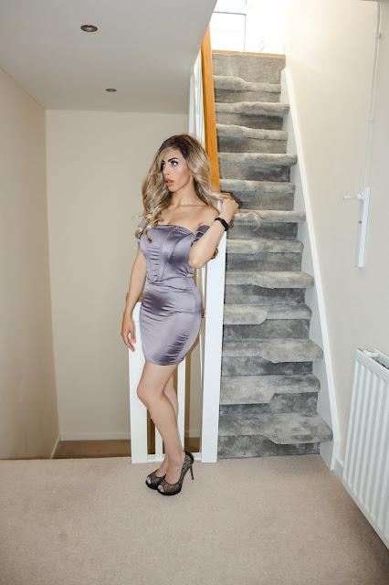 The Femme Luxe Purple Corset Satin Bardot Bodycon Mini Dress in model Jade.