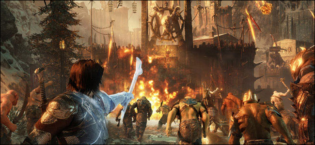 خلفية خيالية بفارس يحمل أسلحة سحرية في المقدمة ويشير نحو جدار قلعة خشبية.
