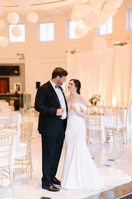 bride and groom smiling in reception