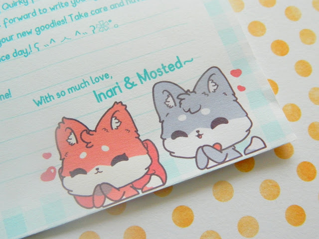 a photo showing two adorable cartoon mascots for the brand Quirkory, a fox and wolf, both of which have cute thankful expressions