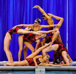 A group of synchronized swimmers in formation